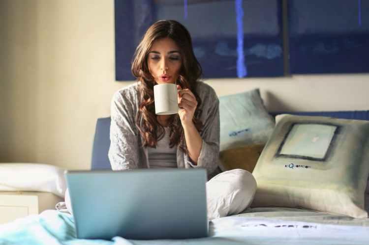 Girl blogging laptop