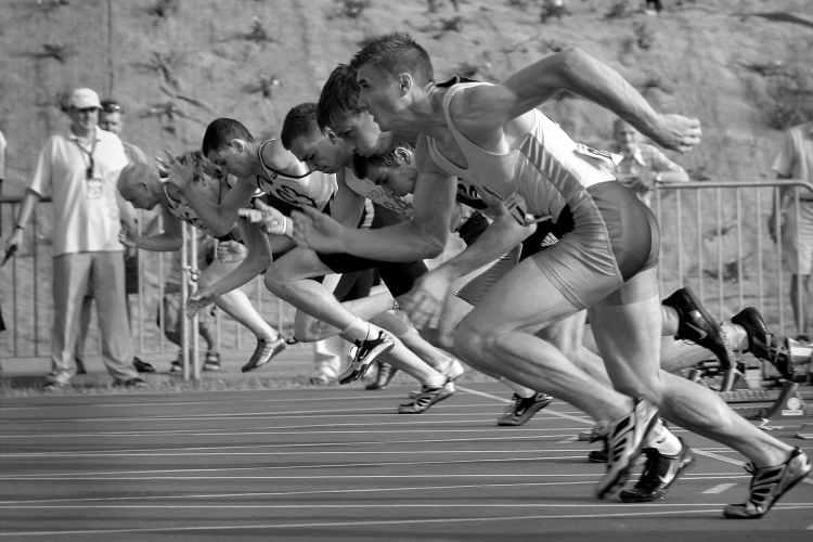 men sprinting running athletics track