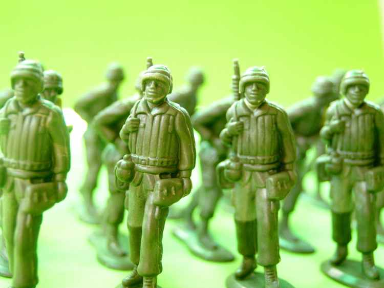 Plastic toy soldiers marching