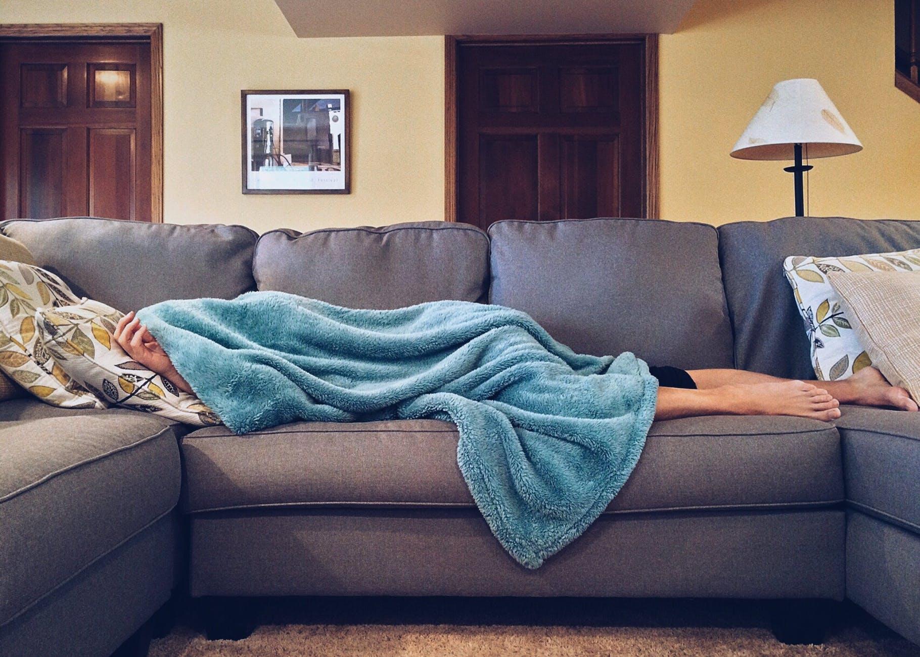 unwell lying on bed