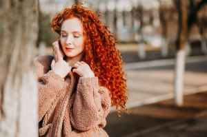woman with curly long red hair